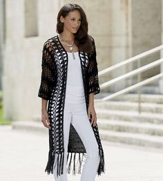 Zoe Fringe Duster from Monroe and Main.  Add drama, mystery and sophistication to any look with one tossing-on of this knit duster. The open weave front creates instant geometric pattern accented by lean, fringed movement.