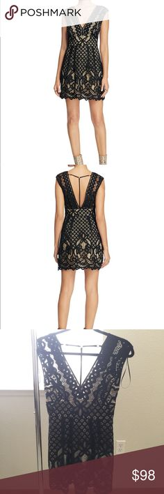 "• free people lace dress • Plunging necklines and a thigh-high hem give this Deco-lace dress from Free People its party-perfect disposition. Self & lining: cotton/nylon Hand wash or dry clean Fits true to size. V-neck with hook-and-eye closures, sleeveless, banded waist Concealed zip side closure, scalloped hem, V-back with T-strap Allover lace overlay, contrast lining Approx. 31"" from back of neck to hem, based on a size 4 Model measurements: 5'10"" height, 33.5"" bust, 23.5"" waist, 34.5""…"