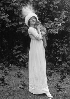 Anna Pavlova,1911 with a cat. I think that is a cat.