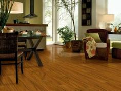 Another low-cost option, laminate flooring is available in styles that mimic hardwood, stone and marble. The surface resists stains and scratches and is easy to clean. Image courtesy of Armstrong Laminate Floors. Walnut Laminate Flooring, Wood Laminate, Hardwood Floors, Küchen Design, Floor Design, Design Room, House Design, Kitchen Flooring Options, Kitchen Floors