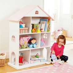 clever to have an open doll's house that functions as a few shelves