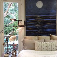 "Sweet dreams to you from our Sea Moon bedroom. Bedding is Belgium linen sheets and shams, embroidered throw pillow and block print cotton quilt. Black walnut side table and vintage findings lamps. Art by @karen_bezuidenhout ""Sea Moon"". Pottery by @globaleyephotography. #sweetdreams #seamoon #belgiumlinen #embroidery"