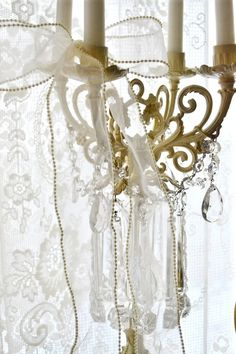 Antique white Chandelier and lace.