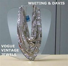 This is a stunning vintage scarf from Whiting & Davis. Most people know these designers for their vintage purses including the mesh ones. The scarf is silvertone mesh (like the purses) and is triangular in shape. It can be worn to the side or can be draped in front as in the picture.