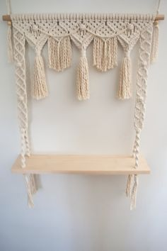 This Fiesta Macrame Shelf with a bunting design is a gorgeous way to display your smaller knick knacks. It is made from natural cotton rope, a pine rod, pine shelf and wooden beads. This hanging shelf is 60cm (23.5) wide and 97cm (38) and the depth of the shelf is 14cm (5.5). There is a 28cm (11) gap between the shelf and the bunting tassels. Each piece is made to order so please allow up to 3 weeks for shipment As each piece is hand made there may be slight variations. We have a range o...