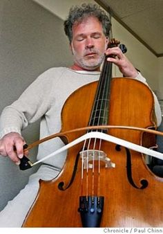 Zounds! (Composer Michael Bach plays a cello using a curved bow, which he designed, in San Francisco, Calif. on Monday, Feb. 18, 2008. Bach's curved bow allows a musician to play all four strings of the instrument at the same time.)   PAUL CHINN/San Francisco Chronicle MANDATORY CREDIT FOR PHOTOGRAPHER AND S.F. CHRONICLE/NO SALES - MAGS OUT Photo: PAUL CHINN / SF