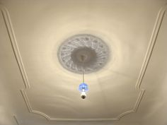 Interior Design Award 2012: the classical ceiling rosette,   painted with light. By Martin Neuhaus