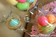 Placed over strands of raffia, plastic Easter eggs look like they're snuggled into a nest!