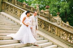 bride and groom on the steps of Bethesda Terrace in Central Park, following their Wedding