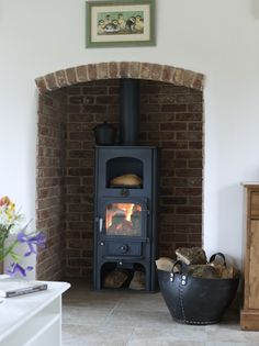 Border Oak - Woodburner in brick fireplace. Red Brick Fireplaces, Wood Heat, Paint Colors For Living Room, Oak Frame House, Exposed Brick Fireplaces, Oak Framed Buildings, Wood Burning Stove, Border Oak, Wood Stove