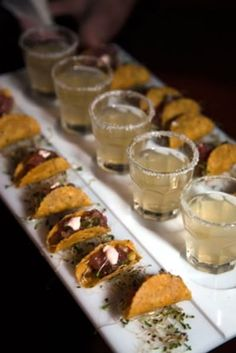 Mini tacos and margaritas in shot glasses. cool idea for cocktail hour, if I drank. hahah