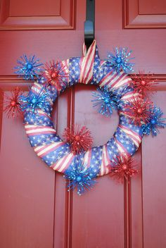 Great 4th of July wreath - $30 or re-create on your own!  We love the mini fireworks :)