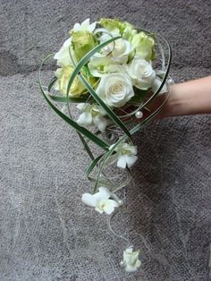bouquet white and greenm roses with white dendrbium orchids with a cascade wire/ www.callaraesfloralevents.com