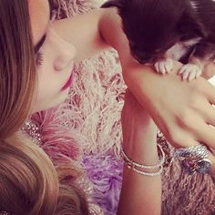 Puppy with dress by Giles and jewellery by Fabergé. 20th April 2012
