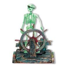 Amazon.com: Action Air® Pirate Skeleton-at-the-Wheel Live-Action Aerating Aquarium Ornament: Pet Supplies