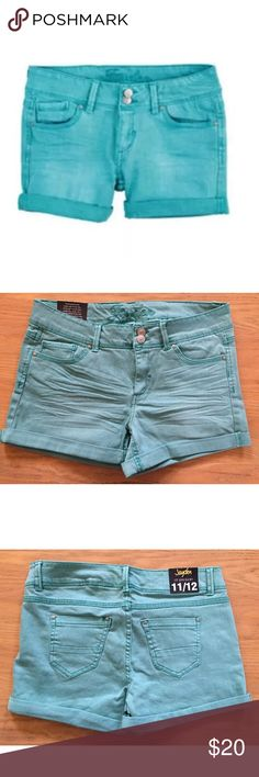 New Delias Jean Shorts 11/12 Denim Turquoise Green New Delias Jean Shorts Womens Size 11/12 Denim Turquoise Green Pockets Cuffed. Delias Shorts Size: Women's size 11/12 Condition: New (no spots/stains/tears) Features: Front/back pockets Measurements: Waist= 16, Length= 10.5, Inseam= 3.5 **All measurements are taken in inches while item is lying flat** delia's Shorts Jean Shorts