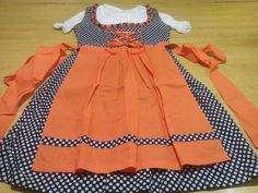 Trachten Dirndl Dress. Made of Polyester/Cotton. A three Piece Dress with an apron, dress and a Blouse. Also Available in Different Colors and Designs 100% Cotton Blouse in White Color.
