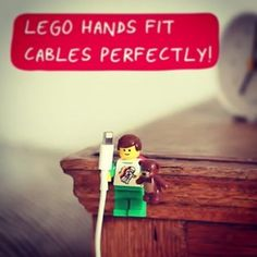 A clever way to repurpose kid stuff. Use Lego people to organize your cables. Their hands the perfect size for cables.
