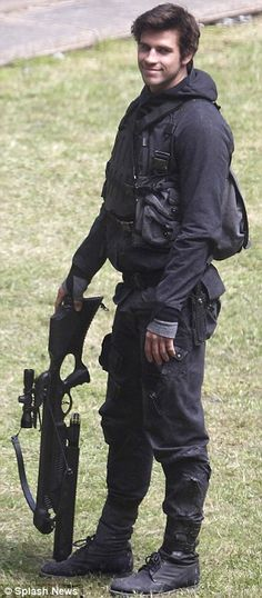 Tactical uniforms: Jennifer and Liam were decked out in combat gear and armed. Mockingjay, hunger games, sinsajo, Gale