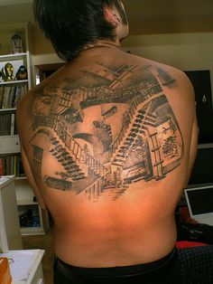 7aae9b3176cd8 A large back tattoo of the stairs of relativity by graphic designer and  artist MC Escher