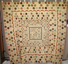 "Mosaic Medallion, Quilt Index Record: 51-8C-F2, IQSC; abt 86"" x 84-87""; date & initials appliqued to front - B.A.1808, begun 1799; cotton, some fussy cutting, English template piecing and hand piecing, some pieces whip stitched together, papers removed, cream cotton, backing in 4 pieces, cotton pink print binding, tin cotton batting, hand quilted w/ white cotton thread, 1-11 spi, echo, parallel lines, made in England by Belle Abrams"