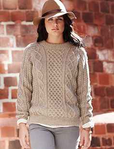 Get ready for cooler weather with this classic aran knit sweater. (Yarnspirations)