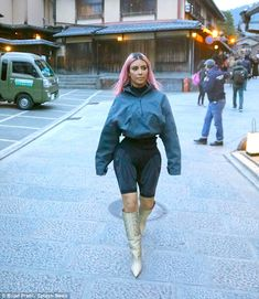 Living doll! Kim Kardashian shows off her sculpted hourglass figure in clinging shorts as ... #kardashian