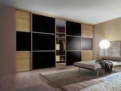 Minima sliding wardrobe doors in oak and black.....stunning