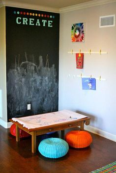chalk board wall for a playroom. love the table with paper on end and poofs for seating chalk board wall for a playroom. love the table with paper on end and poofs for seating Kids Bedroom Organization, Playroom Decor, Playroom Seating, Playroom Table, Playroom Ideas, Chalk Wall, Chalk Board, Chalkboard Wall Playroom, Kids Art Corner