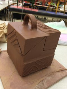 This was the first project of my High School Ceramics Class...to build a box using slab...to handle the surface decoration with repeating textures to create unity, contrast and variety...
