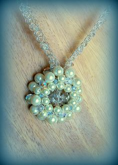 Crocheted wire custom wedding necklace. The bride's late father's wedding ring is wired inside the pendant so she could have him close to her heart on the most important day of her life. CJEWELRY