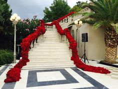 Dramatic red floral stair case decor - Jeff Leatham Gallery