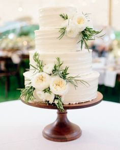 Pam Goddard, of A Piece of Cake, made the four-tier confection featuring red velvet cake with cream cheese frosting and vanilla cake with raspberry cream filling and cream cheese frosting. A garnish of white garden roses provided a lovely finishing touch.