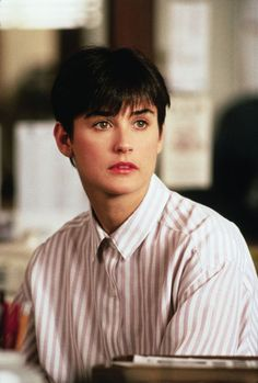 Demi Moore, oversized shirt buttoned all the way to the top, boy short hair, hardly any make up... still hot.