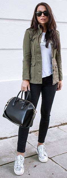 Johanna Olsson wears a classic military style khaki jacket worn with black jeans and metallic print sneakers. Try wearing a similar piece with a skirt or dress to switch up the look but keep that military feel. Shoes: Giuzeppe Zanotti, Jacket: New Look, Top: Balmain, Sunglasses: Olivers People, Bag: Givenchy.