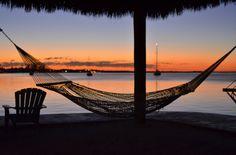 Experience the breathtaking Key Largo sunset from the comfort of a waterfront hammock at Key Largo Bay Marriott Beach Resort.