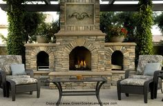 This is the EXACT style Outdoor Stone Fireplace that I've been trying to draw on paper to tell Brian I want to build someday :)