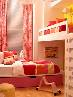 Girl Time - This space for two sisters takes advantage of vaulted ceilings. A lofted bed serves as a cozy sleeping space, while the area underneath is another cozy nook. The second bed is placed on a platform with roomy storage drawers tucked underneath.