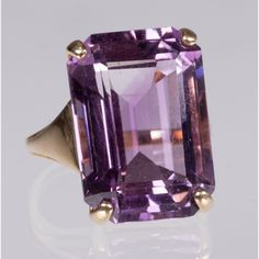 Lot 212 A 14KT. YELLOW GOLD AND AMETHYST RING Est: $700 - $900 Description A 14kt. Yellow Gold and Amethyst Ring, Set with an amethyst measuring approx. 18mm x 13mm. Total weight: 3.9 dwt. Ring size: 6.