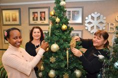 Christmas spirit: From left, City of Burnaby planning department employees Leah Libsekal, Donna Iacobellis and Lina Johannson help raise money for the Marguerite Dixon Transition Society every year. In all, about 20 employees help raise funds. Raise Funds, How To Raise Money, Christmas Wreaths, Spirit, Traditional, City, Holiday Decor, Cities