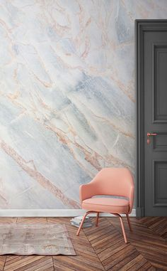 Marble on the walls! This faux marble wallpaper design marries together wonderful shades of icy blues with coral pink. It makes for a stunning accent wall that would look perfect in modern living room spaces.