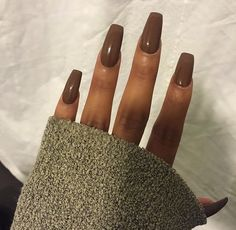 [NAILS: Brown nails beautifully paired w/ brown skin.]