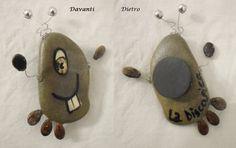 L'alieno Daniela: Questa è una calamita che stavo facendo per il mio frigo, con sasso, semi di anguria, corda di chitarra!!! In realtà l'ho regalata per un compleanno. La adoro!!!