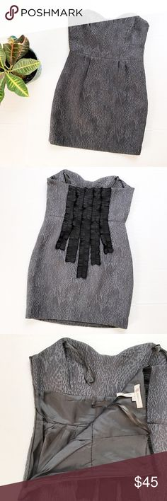 BCBGeneration Textured Strapless Dress Textured strapless dress from BCBGeneration. Size: 6. Color: Grey and Black. Black ruffles down the back, hidden side zip, textured and fitted bodice. Sweetheart neckline. Lined. 99% polyester, 1% spandex. 24 inches down the side seam. BCBGeneration Dresses Strapless