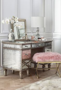 Beneath the dazzling mirrored and gilded surface of our Alessandra Vanity lies a myriad of features that will make any woman feel like a star.
