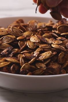Learn how to roast pumpkin seeds and see several different recipes to flavor them. This is a delicious and healthy snack.