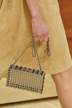 No matter what side of the coin you're on—nickel, copper and gilded hues are finding their way onto bags, and it's all coming up quite luxe.  Pictured: Chanel   - HarpersBAZAAR.com