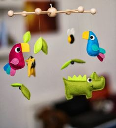 Cute rainforest mobile that apparently was sold on Etsy but doesn't seem to be otherwise available; I have no idea who made this but it's cute and colorful.