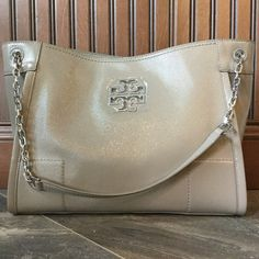 "NWT Tory Burch French Grey Chain Strap Tote Magnetic closure. Zip top compartment. Interior zip pocket at back wall,  adjustable chain strap can be worn as a single or double strap. Beige grey with silver hardware. Measures 10 X 13X6. Drop is 11.5"" on the double Tory Burch Bags Shoulder Bags"