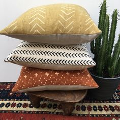 Mud cloth pillows in stock! Rust and black & white tribal patterns make great gifts, or treat yourself.